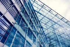 Glass office building with cloudy sky Stock Image