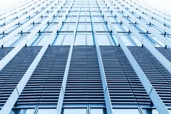 Glass office building facade perspective. Abstract modern architecture background, office building facade perspective, wall made of steel and shiny glass stock photography