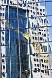 Glass office building with reflections Stock Photography