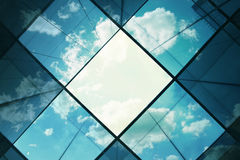 Office building with sky reflections Stock Images
