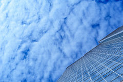 Glass office building skyscraper on a background of clouds Stock Images