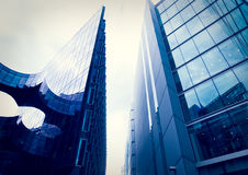 Glass office buildings with cloudy sky Stock Image