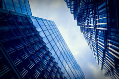 Glass office buildings with cloudy sky Royalty Free Stock Photography