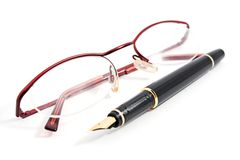 Glass and office fountain pen Stock Photos