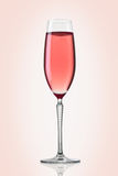 Glass og pink champagne Royalty Free Stock Photos