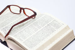 Glass on the old book Royalty Free Stock Images