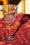 Glass On A Red Table Royalty Free Stock Image
