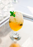 Glass of orage drink with mint Royalty Free Stock Images