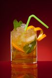 Glass of orange cocktail Stock Images