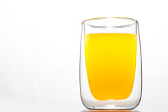 Glass with orange drink Royalty Free Stock Images