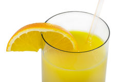 Glass with orange juice. And an orange segment. On a white background Royalty Free Stock Images
