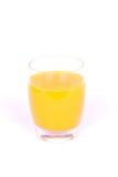 Glass of orange juice. A big full glass of orange juice. Image isolated on white studio background Royalty Free Stock Photo