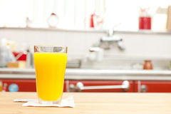 A glass of orange juice. In a kitchen Royalty Free Stock Image