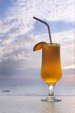Glass of orange juice. On sky background Royalty Free Stock Photography