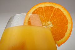 Glass with orange juice. Glass of fresh orange juice with an orange slice Stock Images