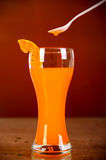 Glass of orange juice on brown background Royalty Free Stock Photography
