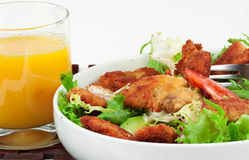 Glass of orange juice with chicken salad Royalty Free Stock Images