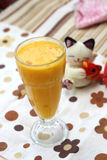 A glass of orange juice on colorful background Royalty Free Stock Images