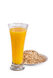 Glass of orange juice and flakes Stock Images