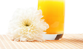 Glass of orange juice and flower Stock Photos
