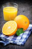 Glass of orange juice and fresh fruits Royalty Free Stock Images