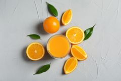 Glass of orange juice and fresh fruits. On table Stock Photos