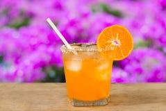 Glass of orange juice and fresh orange  on wooden table Royalty Free Stock Photos