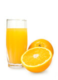 Glass of orange juice and fresh oranges Royalty Free Stock Photo