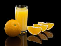 Glass of orange juice with fruit Royalty Free Stock Images