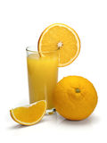 Glass of orange juice with fruit Stock Images