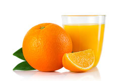 Glass with orange juice and fruits with green leaves isolated Stock Photo