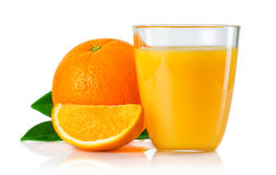 Glass with orange juice and fruits with green leaves isolated on Stock Photography