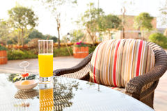 Glass of orange juice and ice cream on table Royalty Free Stock Photos