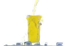Glass of orange juice with ices Stock Image