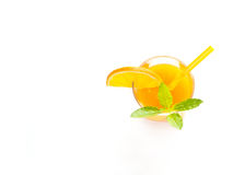 Glass of orange juice with mint  top view on white background Stock Image
