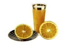 Glass of orange juice and oranges isolated on white background Royalty Free Stock Photos