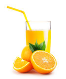 Glass of orange juice and the oranges Royalty Free Stock Photos