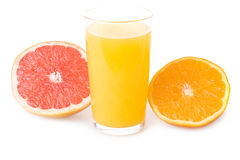 Glass of orange juice and sliced fruits Stock Photo