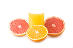 Glass of orange juice and sliced fruits Stock Photos