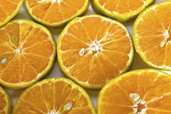 A glass of orange juice and sliced oranges Stock Photography
