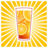 Glass of orange juice. With slices and rays Stock Image