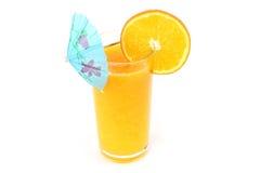 Glass of orange juice with umbrella Royalty Free Stock Photography