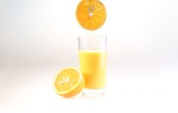 Glass of orange juice on a white background. Juice from fresh oranges stock photography