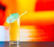Glass of orange juice on wood table Stock Photo