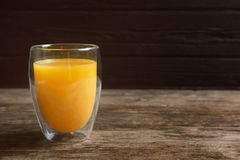 Glass of orange juice. On wooden table royalty free stock photography