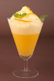 Glass of orange mousse Royalty Free Stock Photos