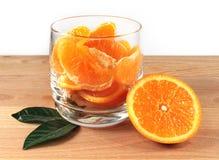 Glass with orange pieces Royalty Free Stock Photos