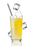 Glass of orange soda drink cold with ice cubes Stock Image