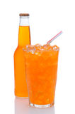 Glass of Orange Soda With Drinking Straw Bottle. A cold glass of orange soda filled with ice and a drinking straw, with a bottle tucked in behind.  Vertical Royalty Free Stock Images