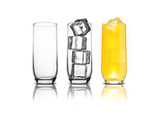 Glass of orange soda with ice cubes empty glass Royalty Free Stock Image